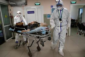 Medical specialists treat patients infected with the coronavirus disease in a hospital in Moscow