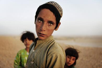 Afghan children stand together near the town of Kunjak in southern Afghanistan's Helmand province
