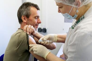 A man receives a dose of Sputnik V (Gam-COVID-Vac) vaccine against the coronavirus disease (COVID-19) at a mobile vaccination centre in a dacha community in Moscow Region