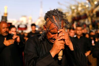 Shi'ite pilgrims flagellate themselves ahead of Ashura, the holiest day on the Shi'ite Muslim calendar in the holy city of Kerbala, Iraq