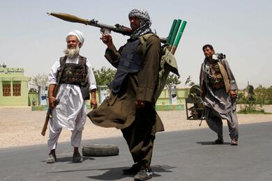 FILE PHOTO: Former Mujahideen hold weapons to support Afghan forces in their fight against Taliban, on the outskirts of Herat province